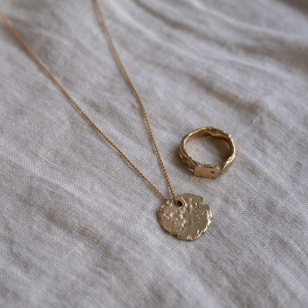 Continent Circular Tag 14kt Gold